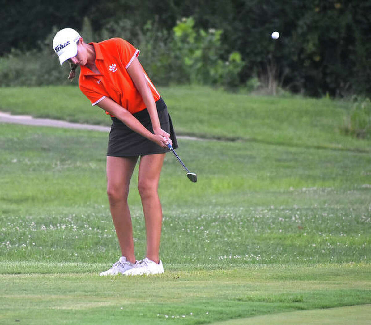 Edwardsville's Nicole Johnson chips onto the green on No. 4 at Woodlands Golf Club during the Alton Kick-Off Scramble/Shamble on Saturday in Alton.