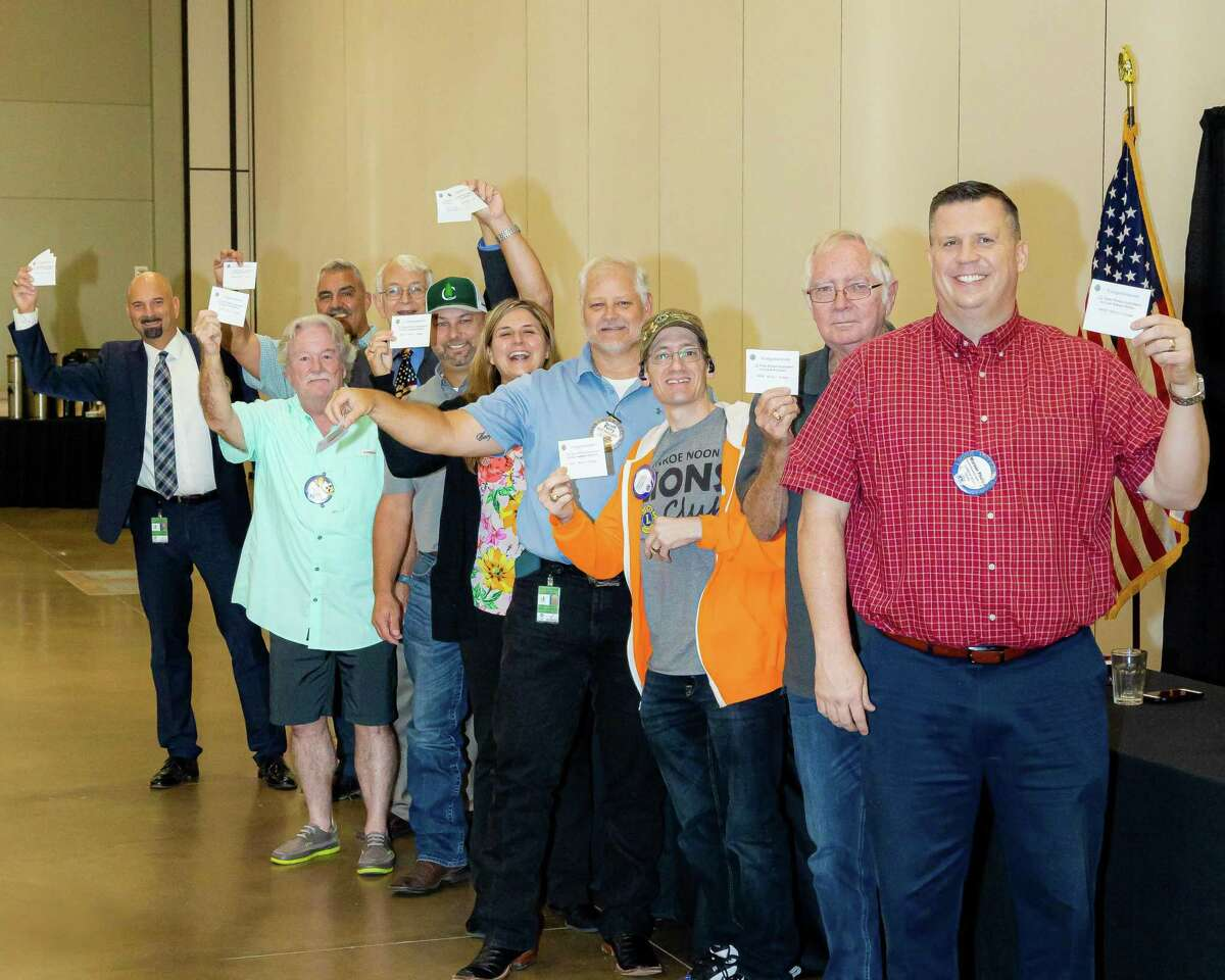 """""""I got mine"""" A group of Conroe Noon Lions Club members received their perfect attendance tabs at last week's club meeting representing over 100 years of perfect attendance. Pictured: (front to back) Warner Phelps, Bob Gunter, Jonathan Gebhardt, Scott Perry, Amanda Anders, Jason Miller, Craig Moore, George Renneberg, Ralph Perez, Steve Williams."""