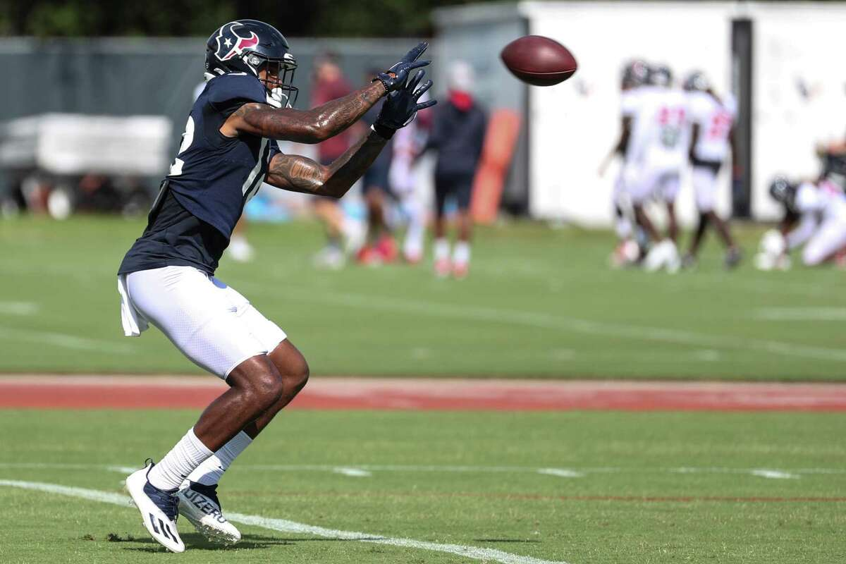 Houston Texans wide receiver Nico Collins turns to make a catch during an NFL training camp football practice Tuesday, Aug. 17, 2021, in Houston.