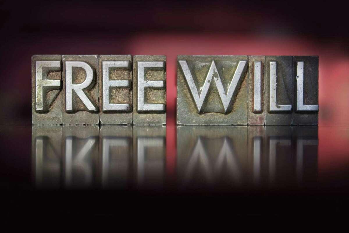 """The words """"Free Will"""" written in vintage letterpress type."""