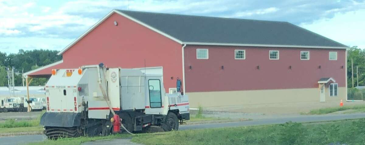 A still shot from a video shows a street sweeper hooked up via hose to a Mechanicville hydrant, prior to Kingsbury Sweeper asking to get a meter for the hydrant.