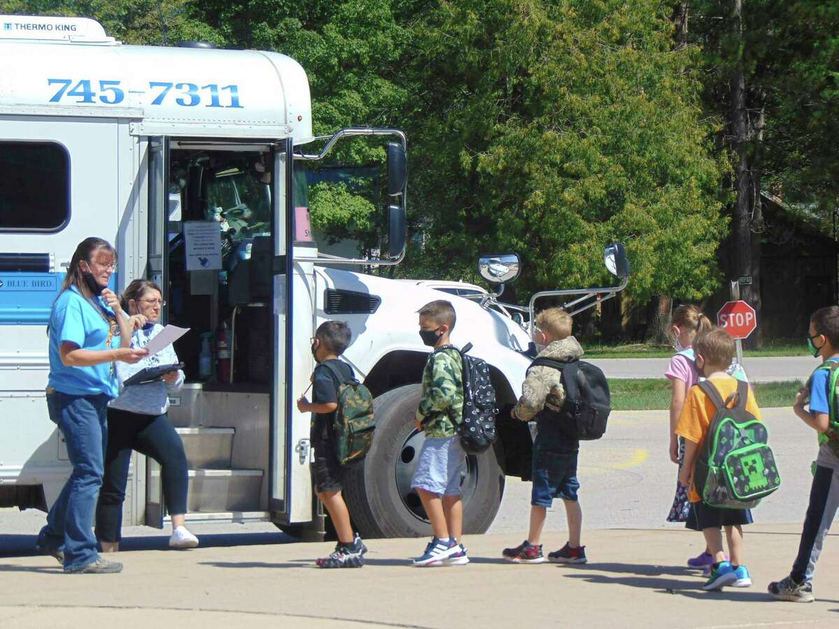 Elementary students loaded into the bus single-filed after a day of class. (Star photo/Shanna Avery)