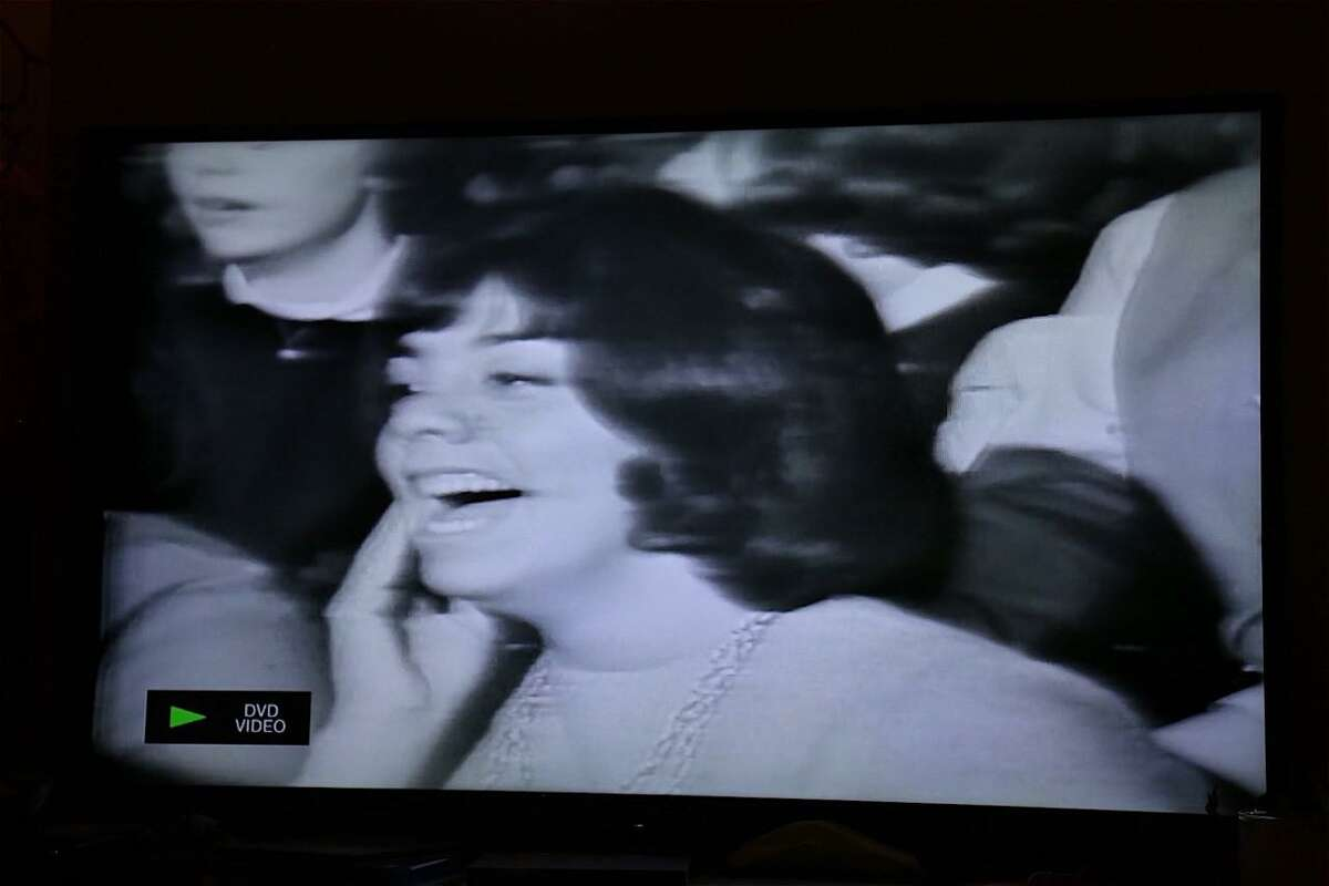 """An iconic shot of Debbie Gendler, formerly of Oakland, N.J., in the audience of The Beatles' first appearance on """"The Ed Sullivan Show"""" Feb. 9, 1964, after their manage Brian Epstein gave her a ticket."""