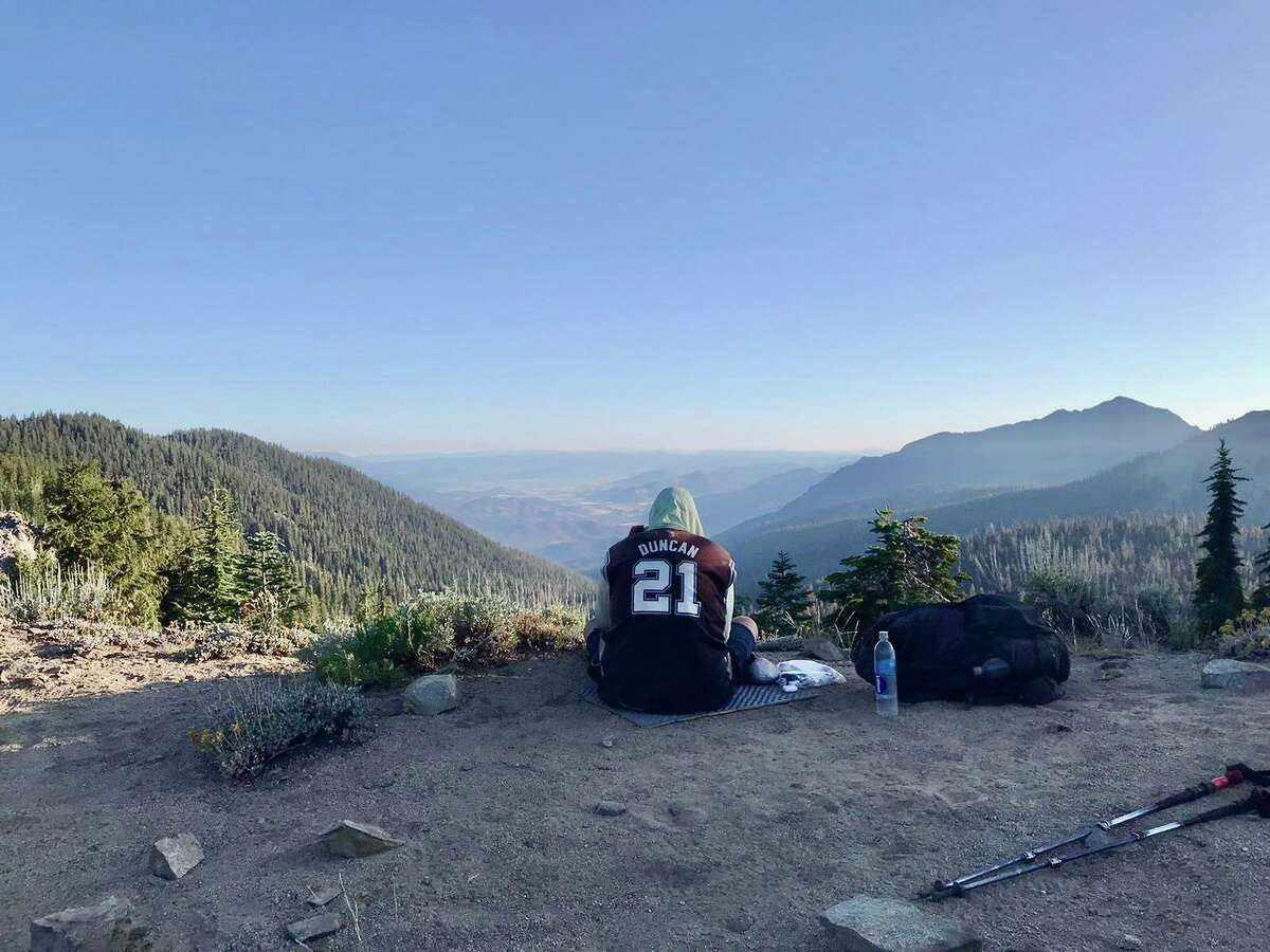 Since April 9, Brian Sporer has been hiking the Pacific Crest Trail while wearing a Tim Duncan jersey. Here he enjoys the view from a mountain crest in Northern California.