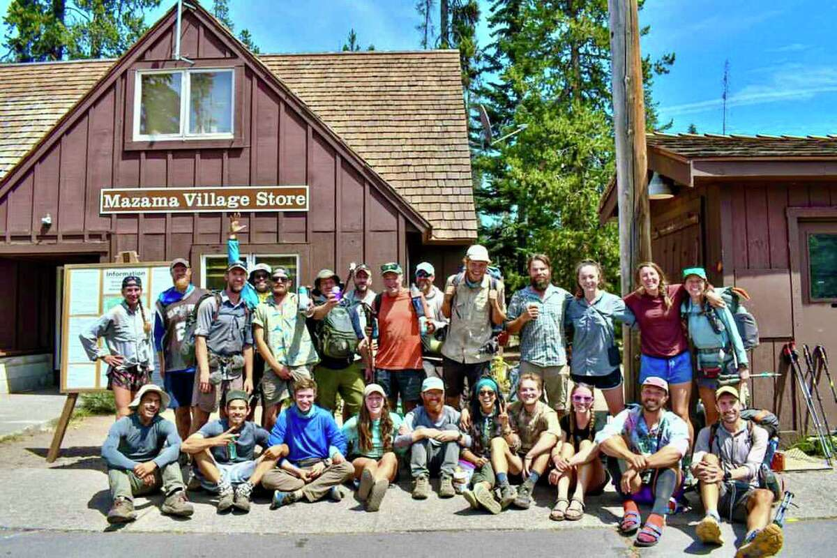 Since April 9, Brian Sporer (standing, second from left) has been hiking the Pacific Crest Trail while wearing a Tim Duncan jersey. Here he poses with fellow hikers at Crater Lake National Park in Oregon.