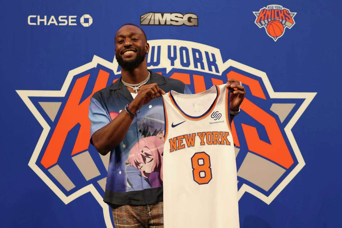 Kemba Walker holds up his No. 8 jersey after being introduced by the Knicks at Madison Square Garden in New York on Tuesday.