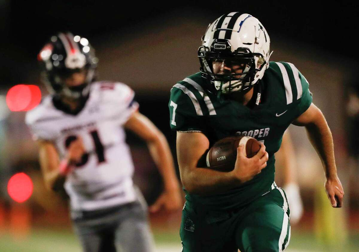 John Cooper running back Jaxson Pierce (7) runs for a 28-yard touchdown during the second quarter of a non-conference high school football game, Friday, Oct. 23, 2020, in The Woodlands.