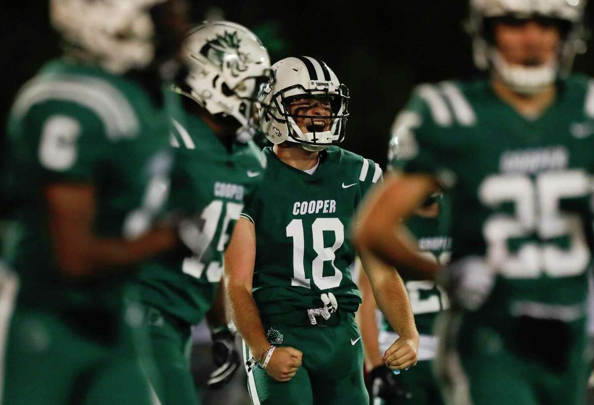 John Cooper outside linebacker Blake Pitts (18) reacts after a tackle during the second quarter of a non-conference high school football game, Friday, Oct. 23, 2020, in The Woodlands.