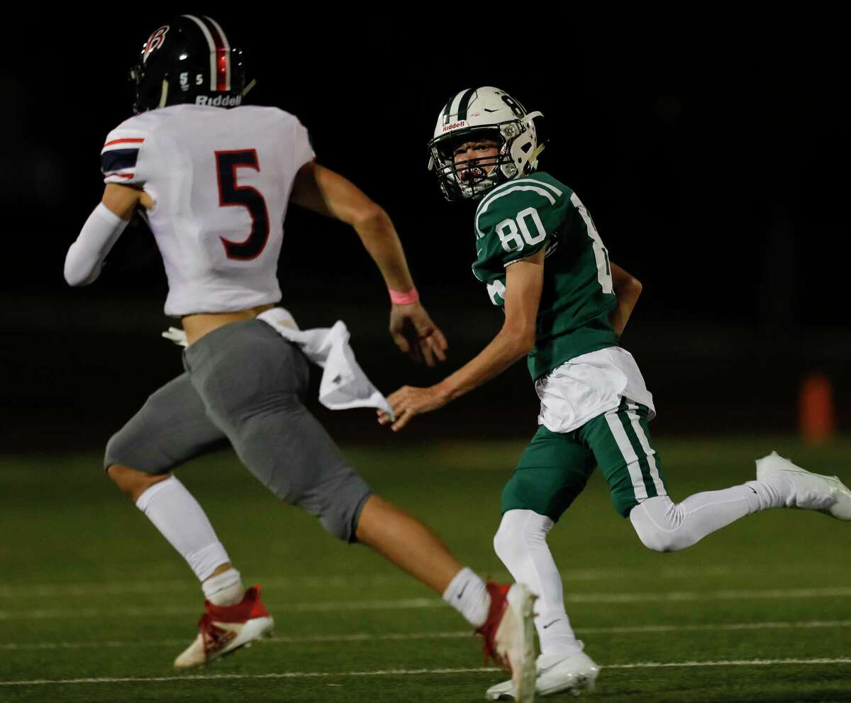 John Cooper's Ronnie Woodall (80) runs down Bay Area Christian's Bryce Griego (5) during the first quarter of a non-conference high school football game, Friday, Oct. 23, 2020, in The Woodlands.