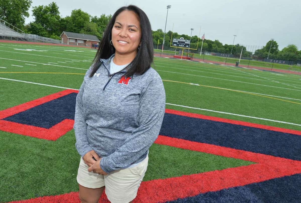 Ashley Labrador, an Atheletic Director at Brien McMahon High School stands on Jack Cassagrande Field on Thursday May 31, 2018 in Norwalk Conn. where she performed CPR and saved the life of a spectator at an event.