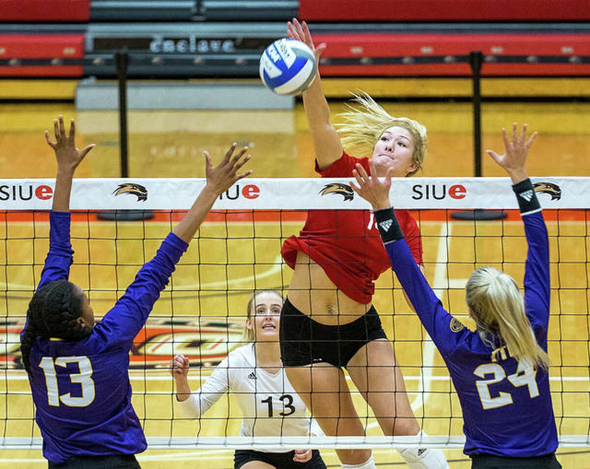 SIUE's Savannah Christian (middle), shown in action last season, earned a spot on the 14-member preseason All-OVC team. The redshirt sophomore, a Washington, Missouri, native, hit at a .343 clip last season and notched 110 kills. Christian's efforts last spring gave her a spot on the All-OVC Second Team.