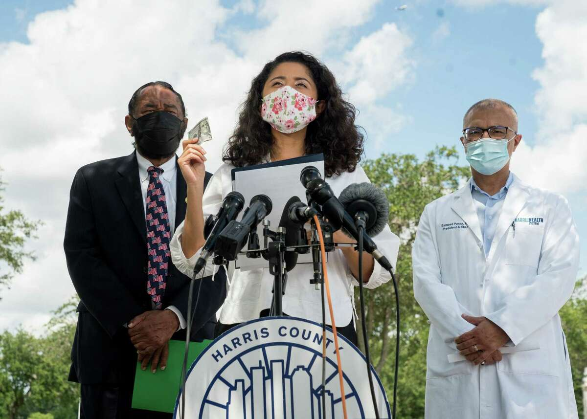 Harris County judge Lina Hidalgo announced that each person getting their first COVID-19 vaccine will receive $100, during a press conference at NRG Park on Tuesday, Aug. 17, 2021, in Houston. The new public health initiative is an attempt to address the ongoing COVID-19 emergency.
