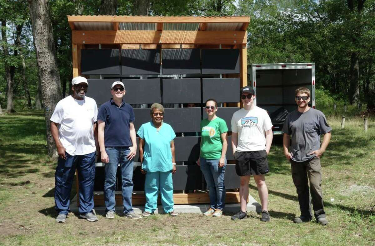 Designers finished the project on Saturday, and were given an appreciation luncheon. A group of those who were present are pictured with the pavilion. (Courtesy photo)