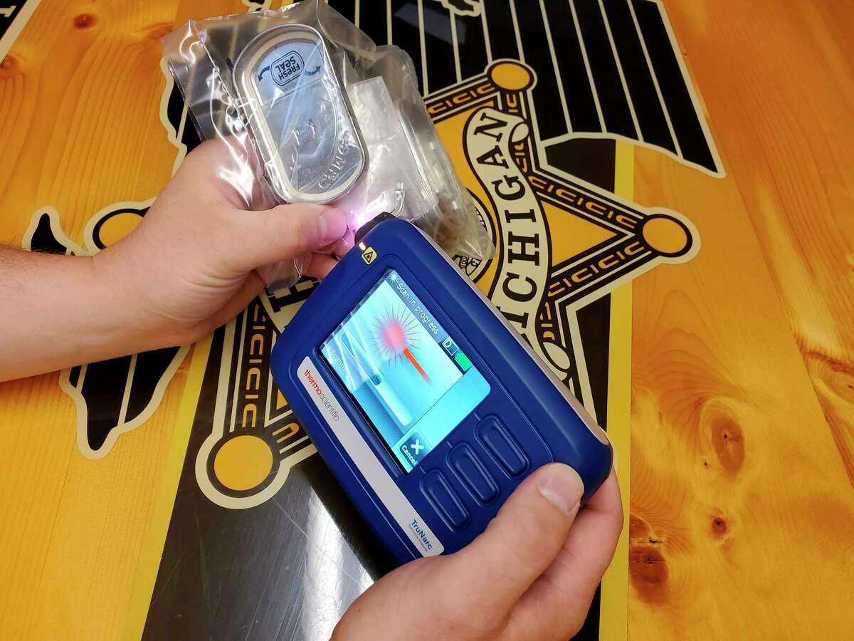 The TruNarc device protects officers fromaccidental drug exposure by testing through plastic. (Scott Nunn/Huron Daily Tribune)