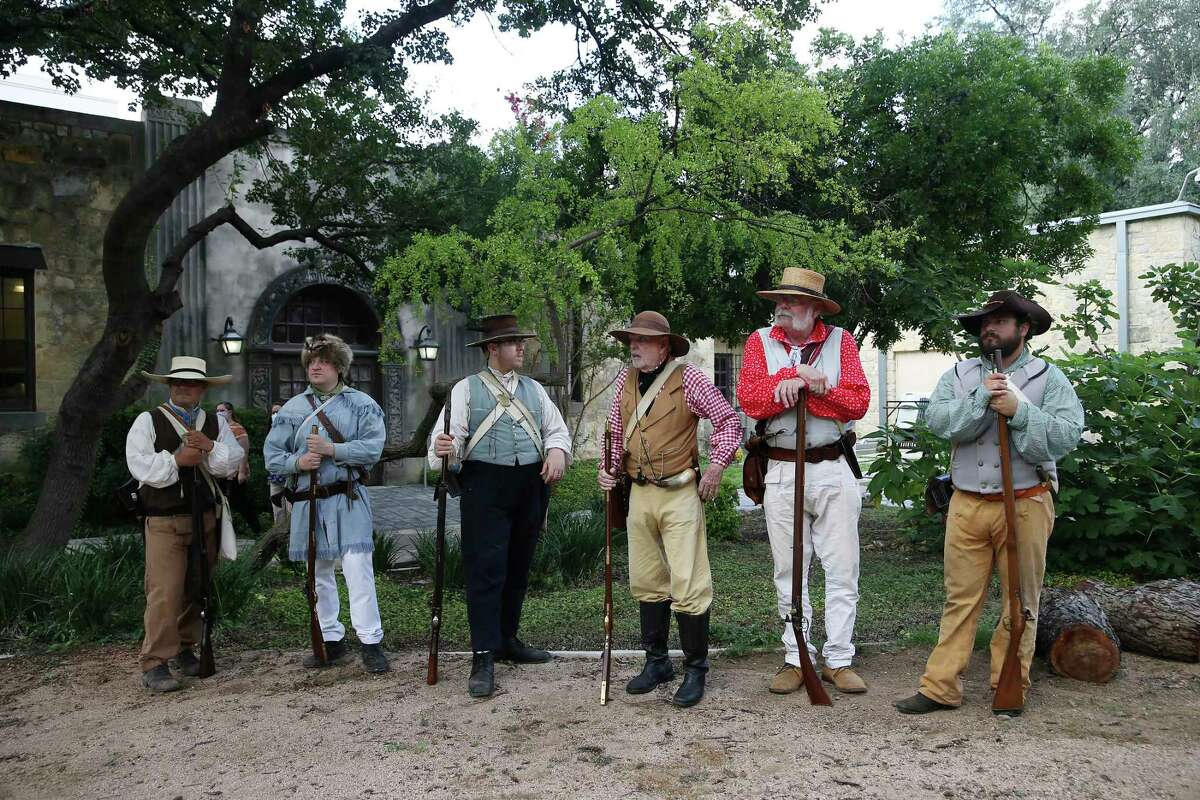 Alamo re-enactors wait for the start of the Alamo Exhibit Hall and Collections Building groundbreaking ceremony Tuesday. The $15 million facility is scheduled to open in fall of 2022.
