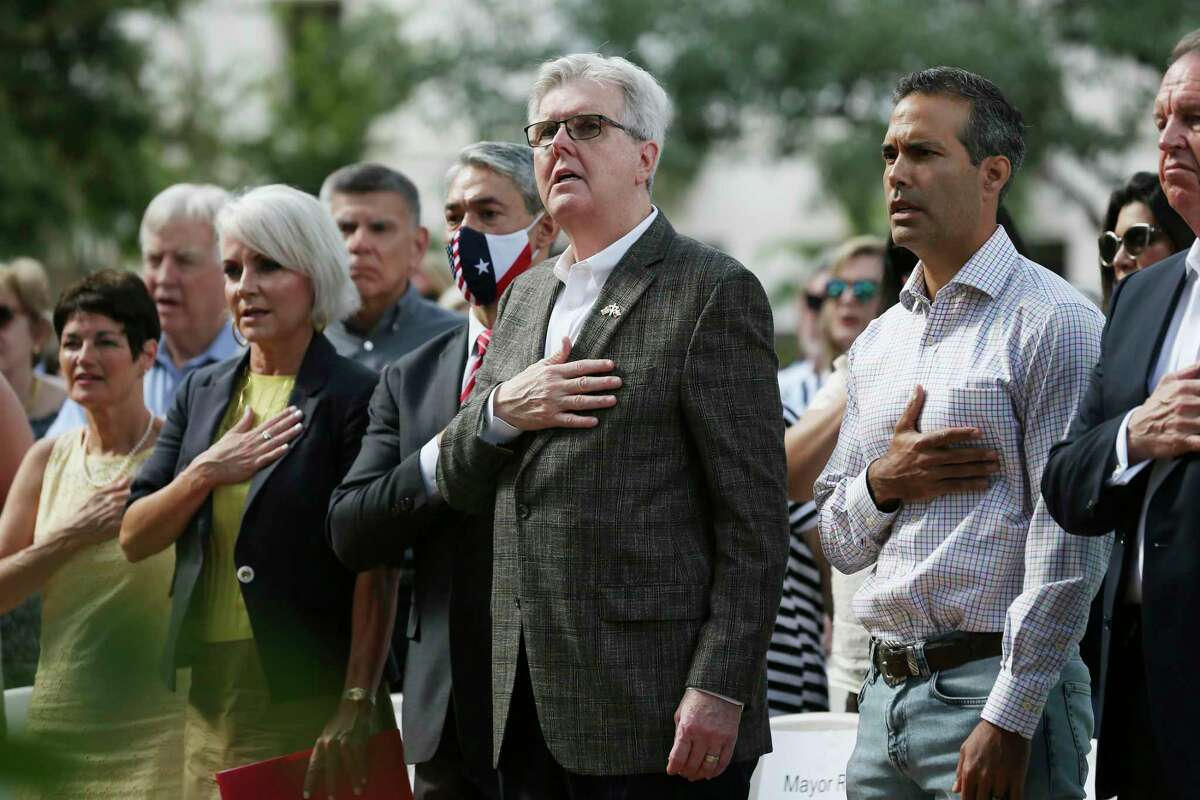 Local and state officials from left, State Rep. Donna Campbell, Bexar County Commissioner Trish DeBerry, San Antonio Mayor Ron Nirenberg, Lt. Gov. Dan Patrick, Land Commissioner George P. Bush and Welcome Wilson Jr., chair of the Alamo Trust, salute the flag during the Alamo Exhibit Hall and Collections Building groundbreaking ceremony Tuesday. The $15 million facility is scheduled to open in fall 2022.