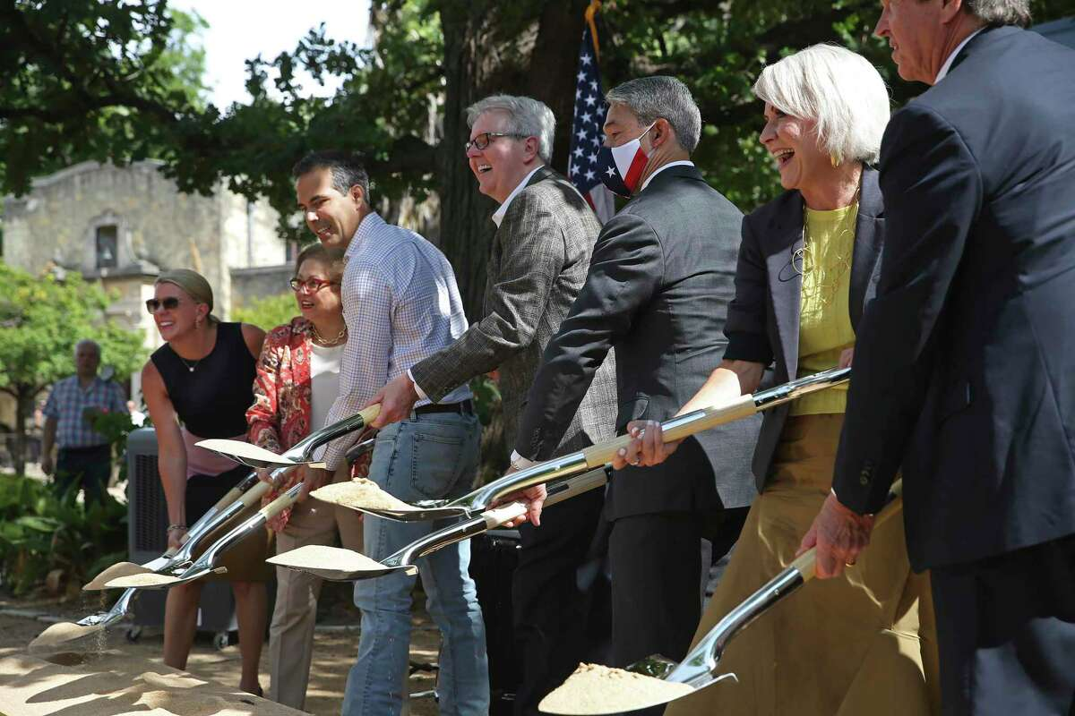 From left, Alamo Executive Director Kate Rogers, Alamo Trust board member Hope Andrade, Texas Land Commissioner George P. Bush, Lt. Gov. Dan Patrick, Mayor Ron Nirenberg, Bexar County Commissioner Trish DeBerry and Alamo Trust Chair Welcome Wilson, Jr. participate in the groundbreaking ceremony for the Alamo Exhibit Hall and Collections Building Tuesday.