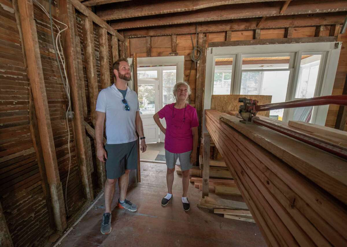 """Evan Williamson and his mother Susan Brundige look at the home he and his wife Whitney are renovating in Saratoga Springs. A crew from the reality show """"This Old House"""" is filming the renovation of the home, which has been in the family since 1864."""