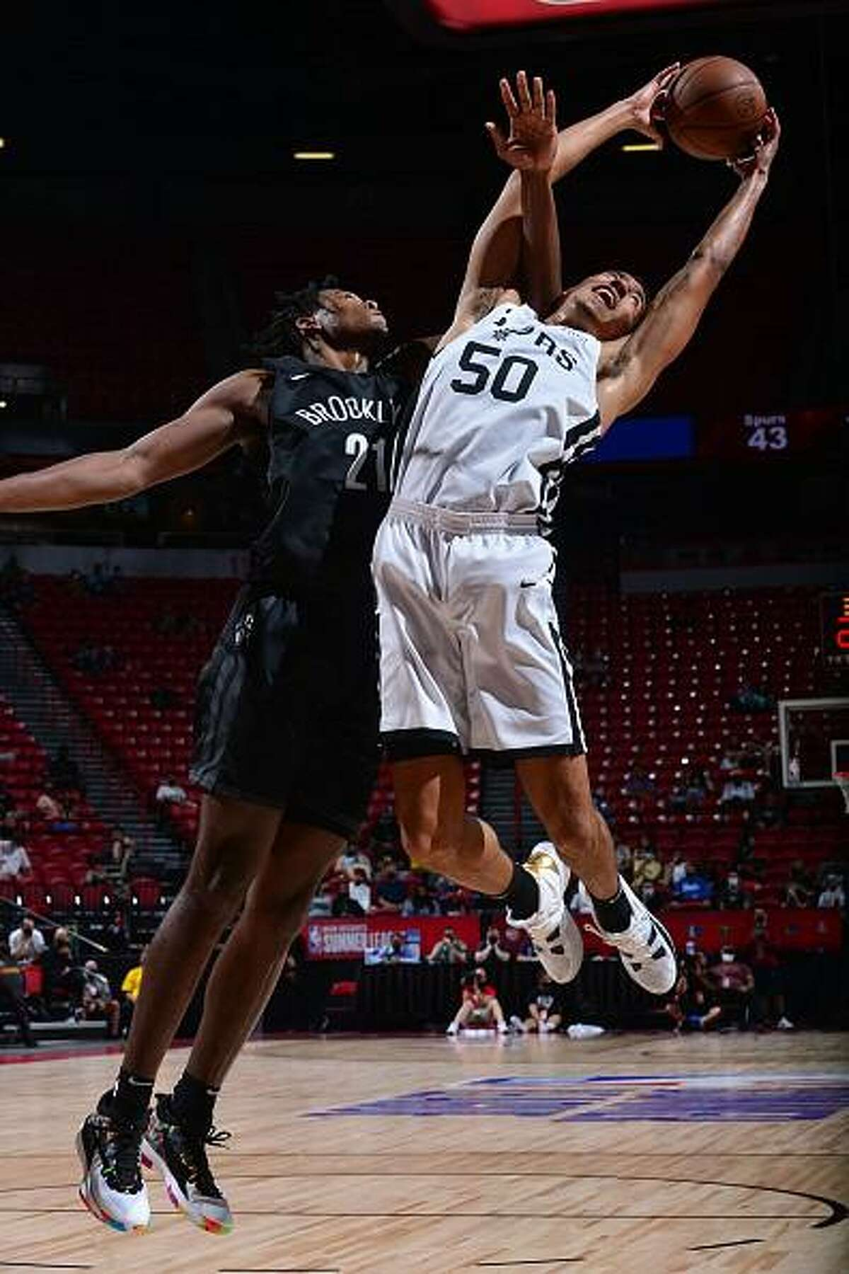 Justin Robinson #50 of the San Antonio Spurs rebounds the ball against the Brooklyn Nets during the 2021 Las Vegas Summer League on August 15, 2021 at the Thomas & Mack Center in Las Vegas, Nevada.