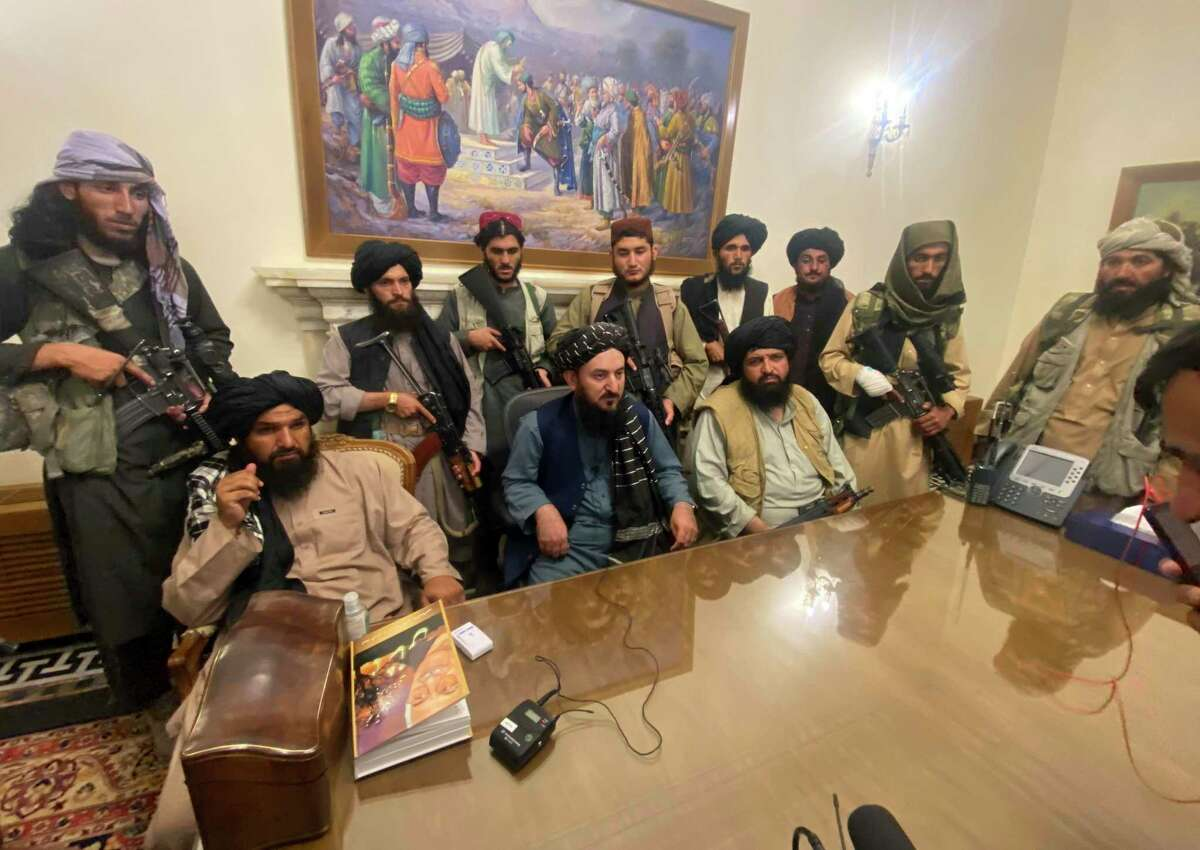 A reader and veteran expresses his frustration about the failure in Afghanistan and the hubris of nation building. Here, Taliban fighters take control of Afghan presidential palace Sunday.