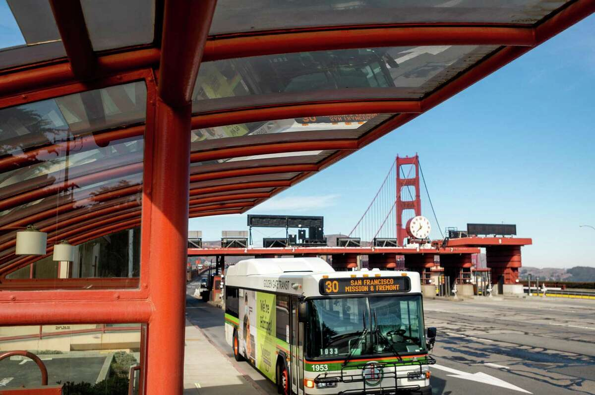 A bus passes the Golden Gate Bridge toll plaza in San Francisco, Calif. The bridge district launched an investigation after flyers threatening district employees were disseminated at several of the agency's buildings.