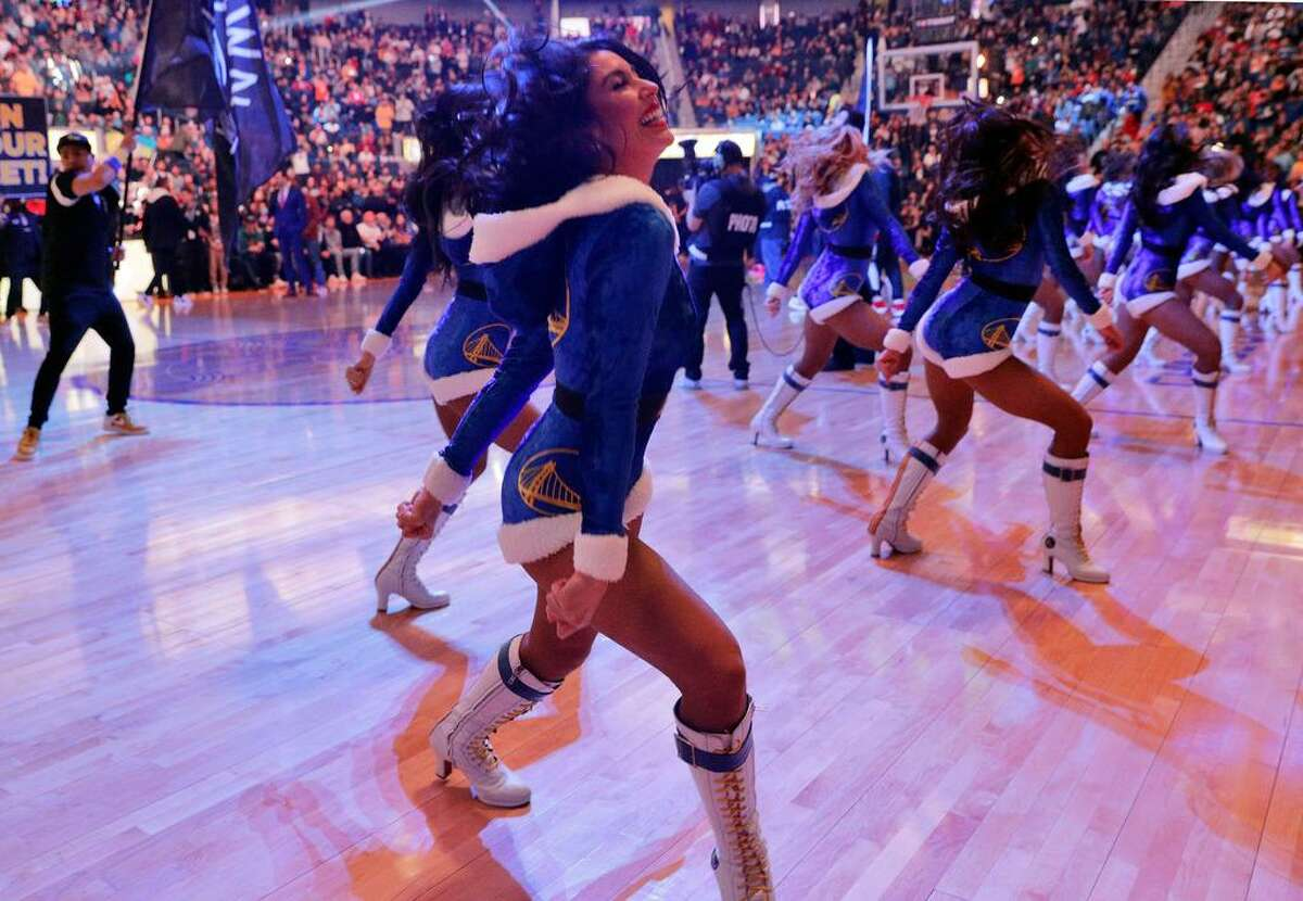 Golden State Warriors Dance Team members perform in their Christmas outfits before the Golden State Warriors played the Houston Rockets at Chase Center in San Francisco, Calif., on Wednesday, December 25, 2019.