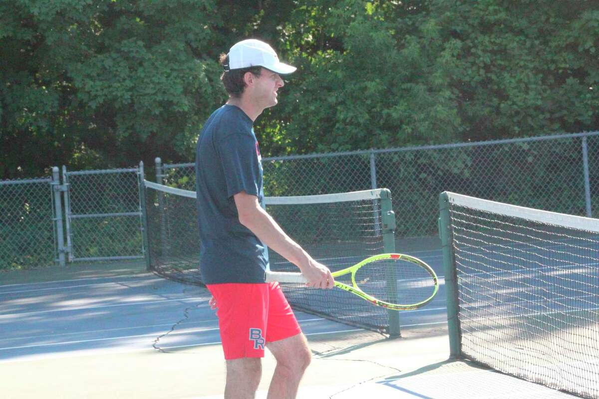 Big Rapids tennis coach Austin Brinker approaches the net during a recent practice. (Pioneer file photo)