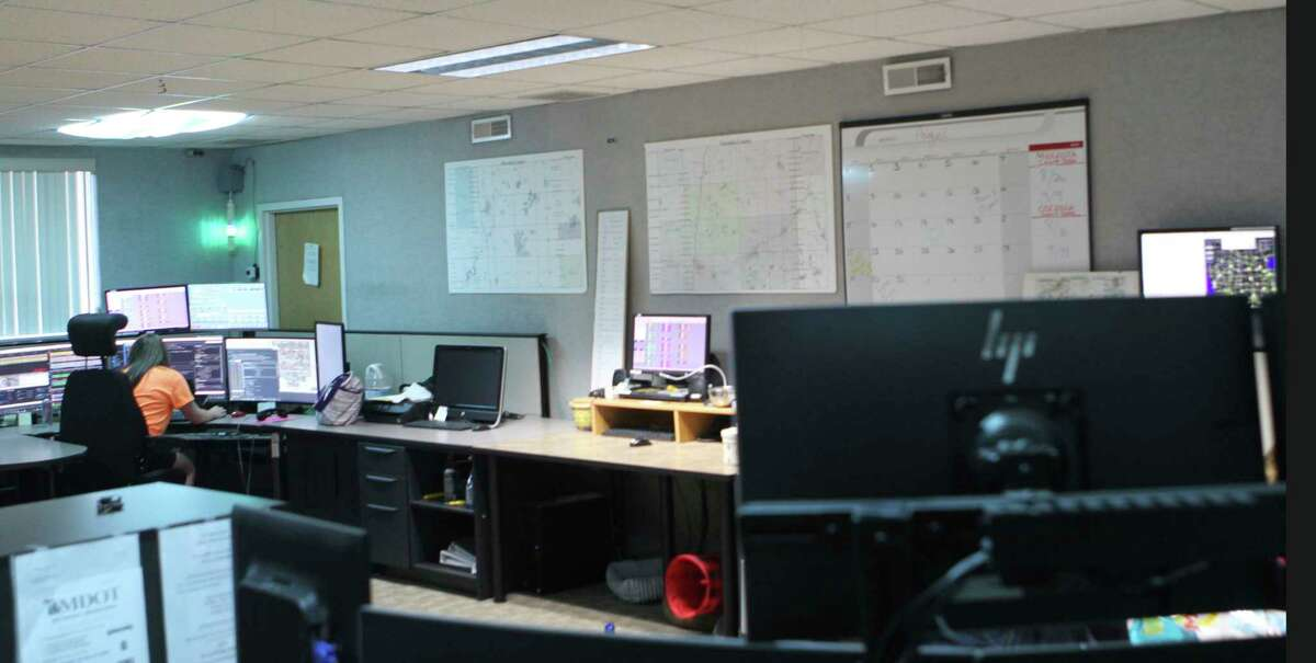 Charts, maps and calendars line the walls of the Meceola Central Dispatch. (Pioneer photo/Joe Judd)
