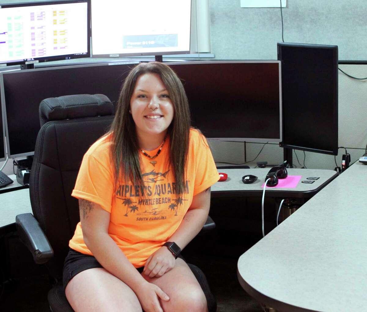 Meceola Central Dispatch worker Sydney Sanders says she enjoys assisting the public. (Pioneer photo/Joe Judd)