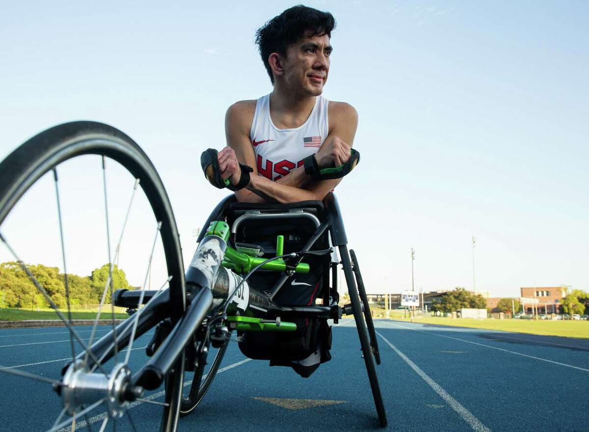 Top: Paralympian Ray Martin, who races in a wheelchair, was born with a congenital disability called arthrogryposis. Above: Martin has been training in the heat and humidity of Houston in preparation for the Tokyo Paralympic Games.