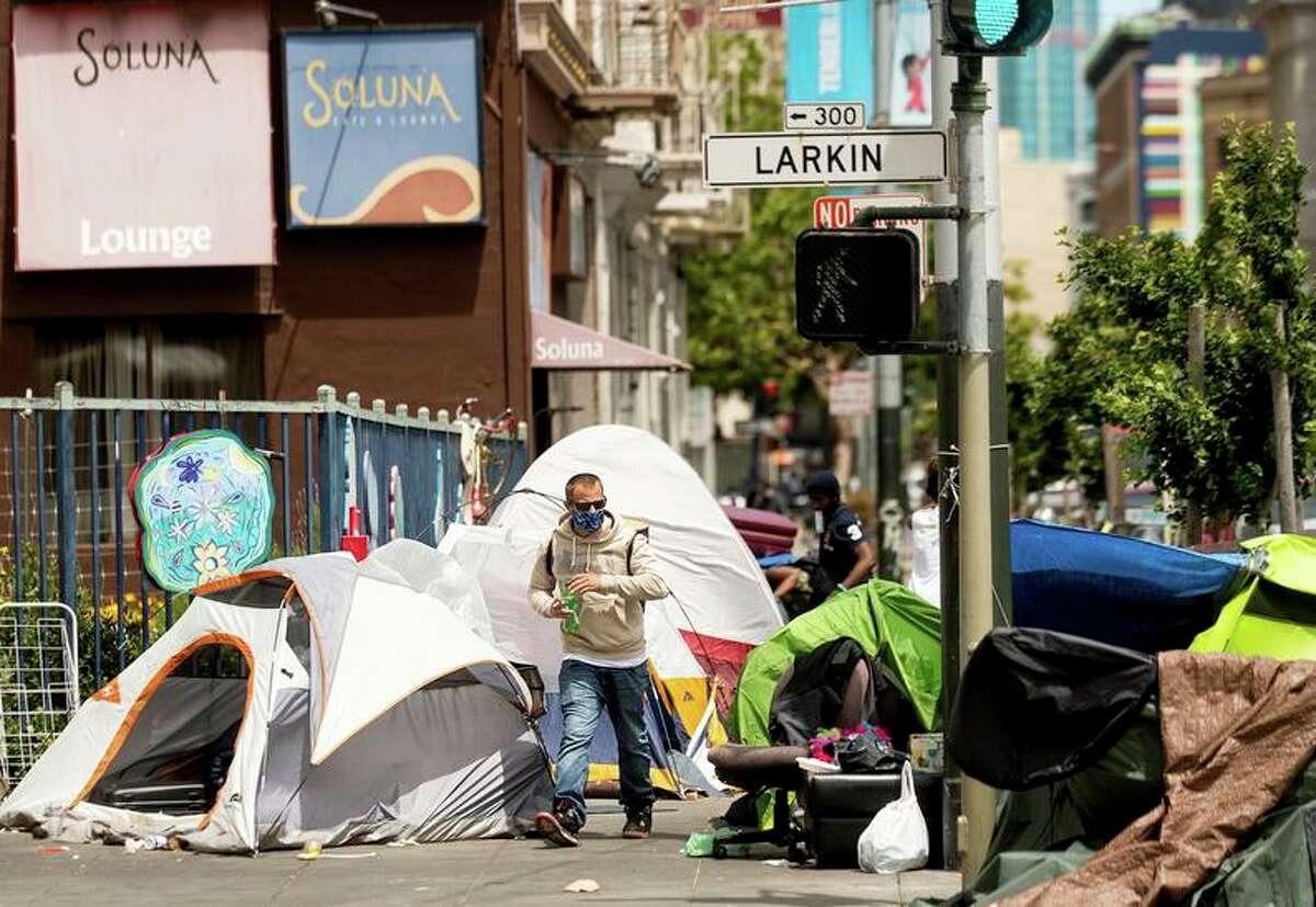 Tents housing homeless people line a street in San Francisco's Tenderloin neighborhood in June last year.