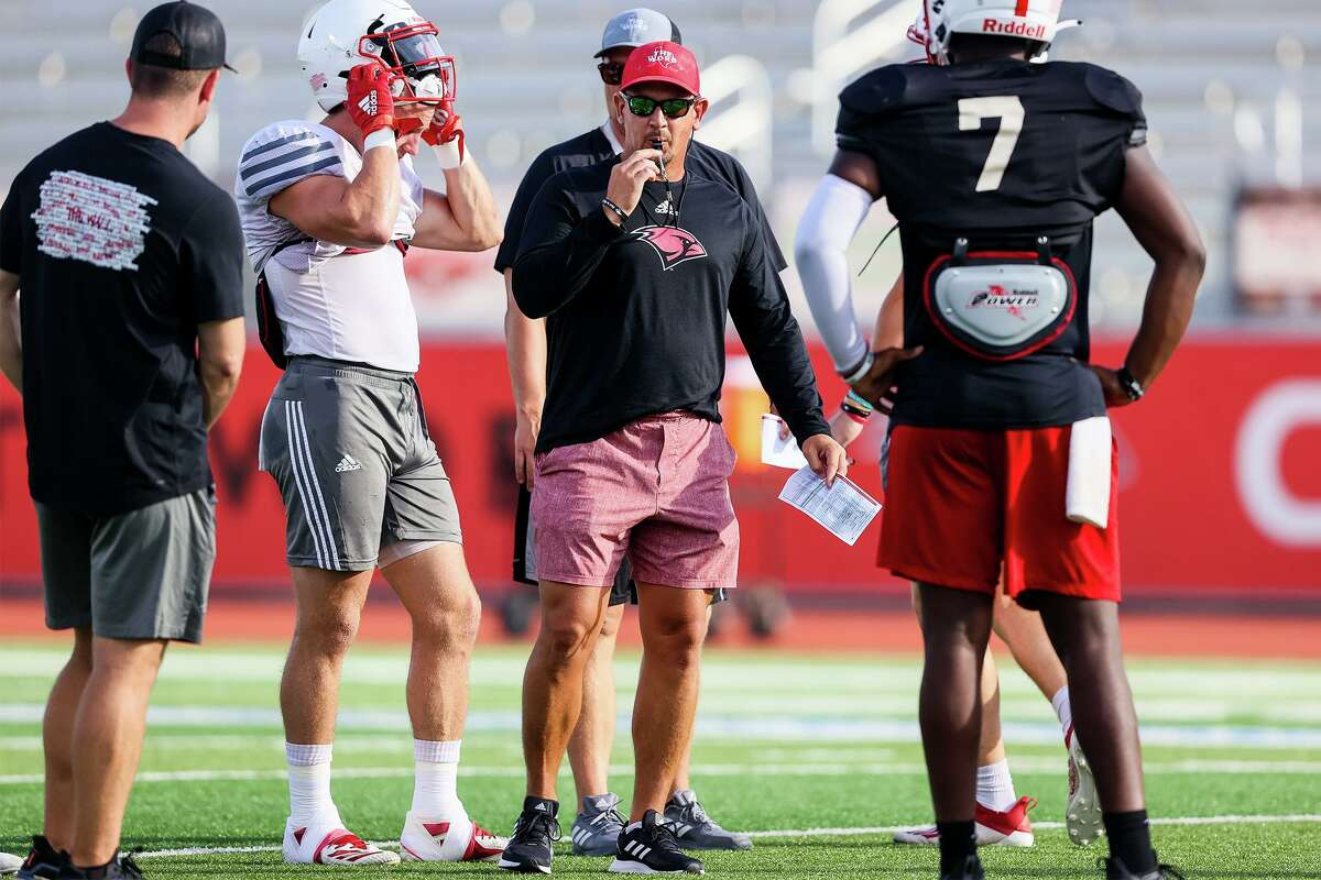 UIW head football coach Eric Morris, center, conducts a morning practice at Gayle and Tom Benson Stadium on Friday, Aug. 13, 2021.