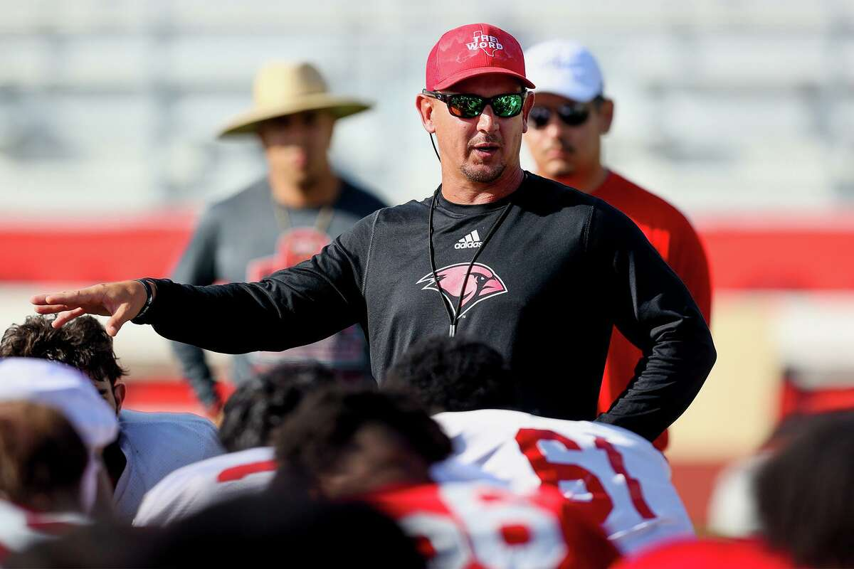 UIW head football coach Eric Morris talks to the Cardinals at the conclusion of a morning practice at Gayle and Tom Benson Stadium on Friday, Aug. 13, 2021.