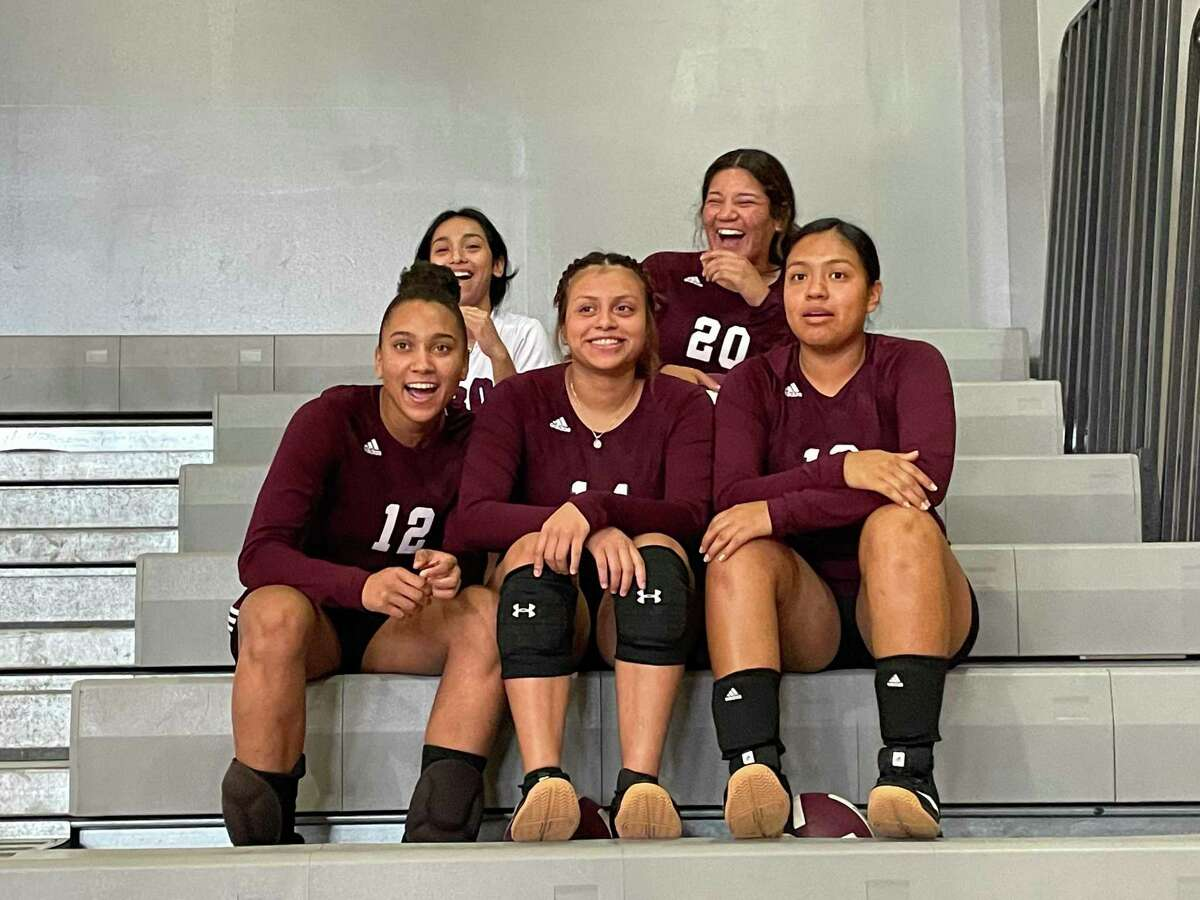 A group of Northbrook volleyball players hang out in the stands prior to their home match on Aug. 13.