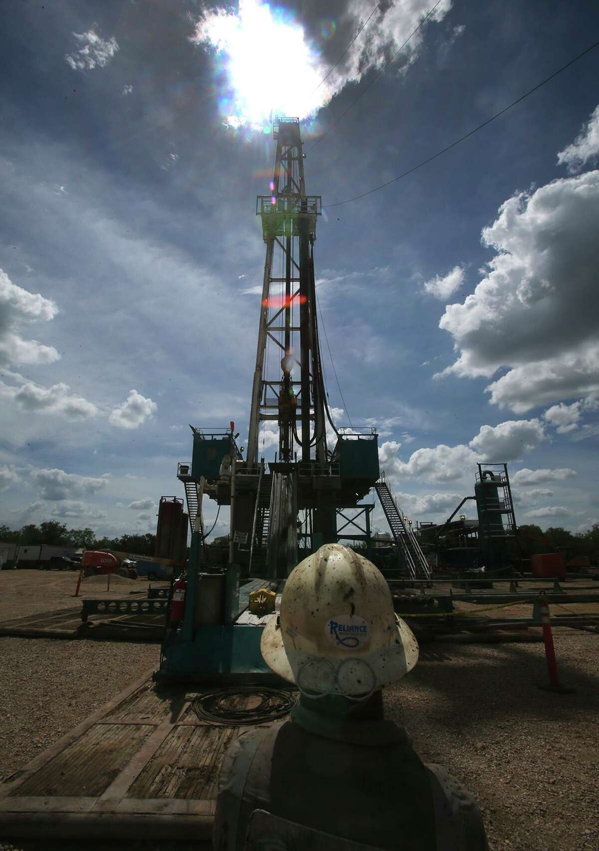 Floor hand Robert Baker looks at Abraxas Petroleum's Bullseye 101H well being drilled on Monday June 27, 2016 in the Austin Chalk formation in Atascosa County near Jourdanton, Texas.