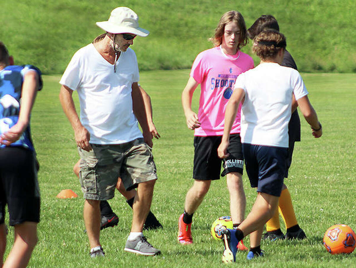 East Alton-Wood River boys soccer coach Mike Lawson keeps a close eye on his players as they go through a footwork drill during practice Tuesday at Wood River Soccer Park. The Oilers will open their season Aug. 24 at home against Staunton.