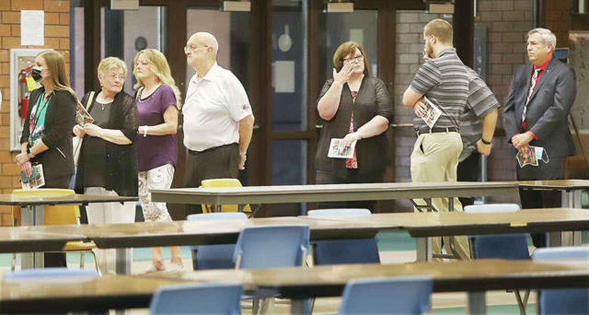 Hundreds of people attended the five-hour long visitation for John and Melissa Cafazza, and their youngest child, Dominic, 12, Tuesday evening in the gymnasium of Civic Memorial High School in Bethalto. Hundreds filed through the high school cafeteria on their way to the gymnasium. The three were killed in a two-vehicle traffic crash that occurred about 7:45 p.m. Friday near Fosterburg. John Cafazza was 55 and Melissa Cafazza was 52.