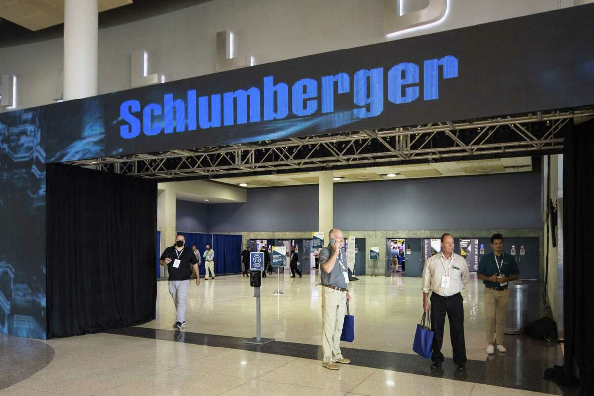 Schlumberger signage remains on the exhibition floor after the company withdrew from the conference due to Covid-19 concerns at the Offshore Technology Conference in Houston, Texas, U.S., on Monday, Aug. 16, 2021. The annual Offshore Technology Conference draws visitors from around the world to Houston and is one of the largest oil confabs to resume in-person attendance since the global pandemic began last year. Photographer: F. Carter Smith/Bloomberg