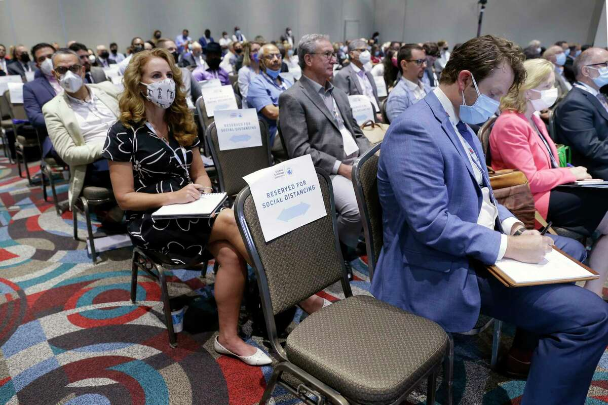 Attendants are socially distanced in the meeting room as they listen to speakers in the opening general session during day 1 of the Offshore Technology Conference, held at the NRG Center Monday, Aug. 16, 2021 in Houston, TX.