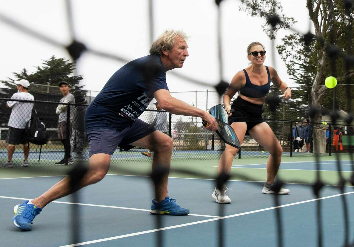 Derrick Marsh and Kate Stoia play pickleball at the courts near Louis Sutter Playground in San Francisco's McLaren Park. In recent years, there has been an explosion of interest in pickleball, America's fastest-growing sport.
