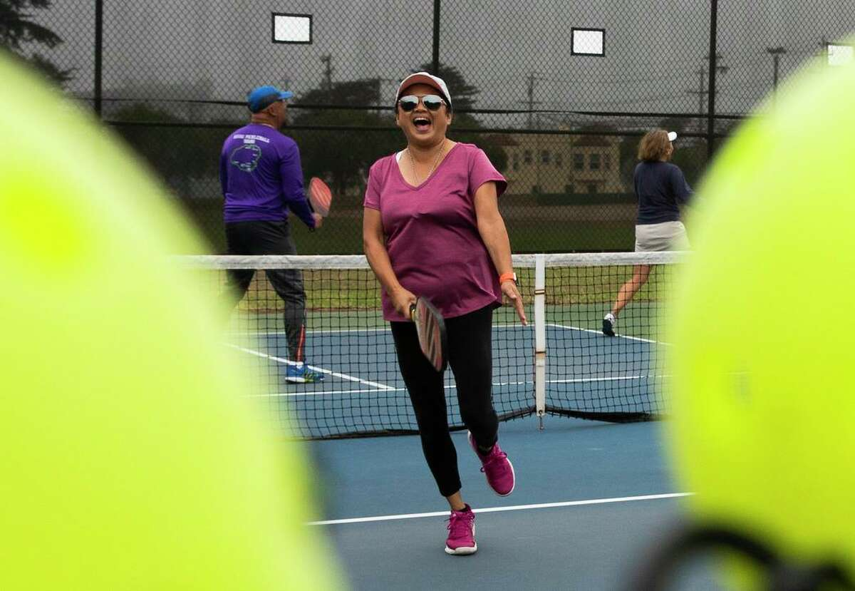 Shelly Thomas cheers after scoring a point while playing pickleball at the courts near Louis Sutter Playground in McLaren Park.