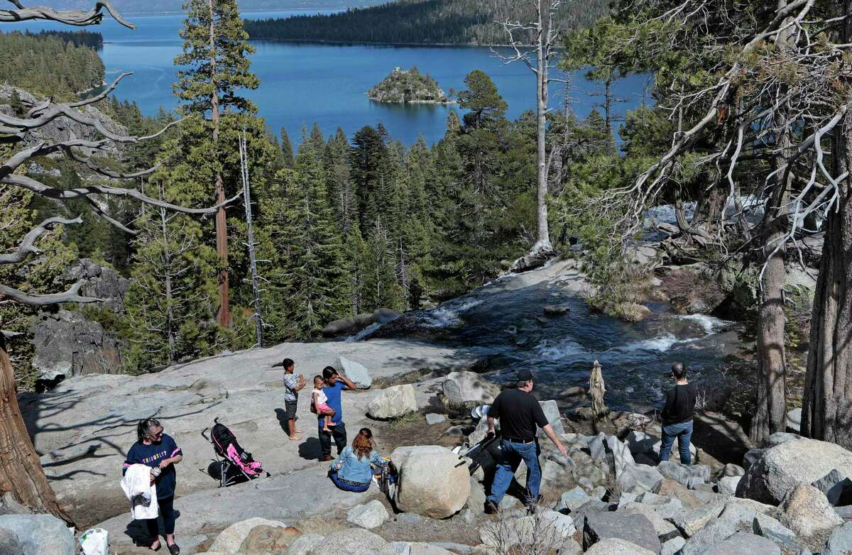 People gather at the Emerald Bay overlook in South Lake Tahoe last year. Campfires are no longer allowed at state parks in much of the High Sierra, including the areas around Lake Tahoe.