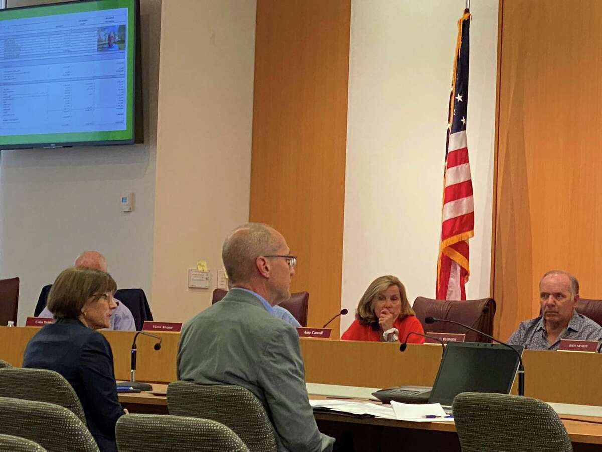 Executive Director of the New Canaan Library Lisa Oldham and CFO of Karp Associates Paul Stone presented an update on the new library project in Town Hall on Aug. 5.