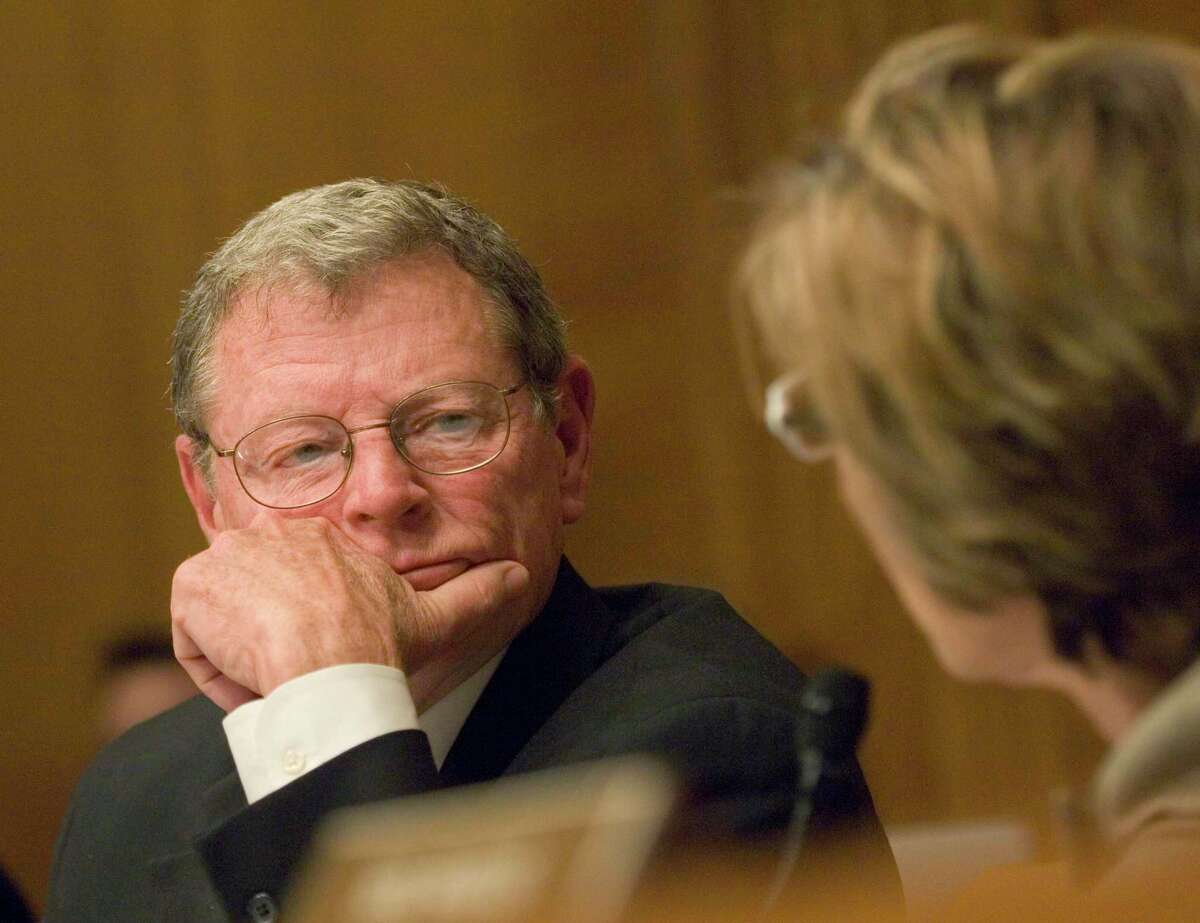 Sen. Barbara Boxer (D-Calif.), chairman of the Environment and Public Works Committee, argues with Sen. James Inhofe (R-Ok.), left, about procedural matters as former Vice President Al Gore was testifying on global warming before on Capitol Hill March 21, 2007. Inhofe challenged Gore on the science of global warming.