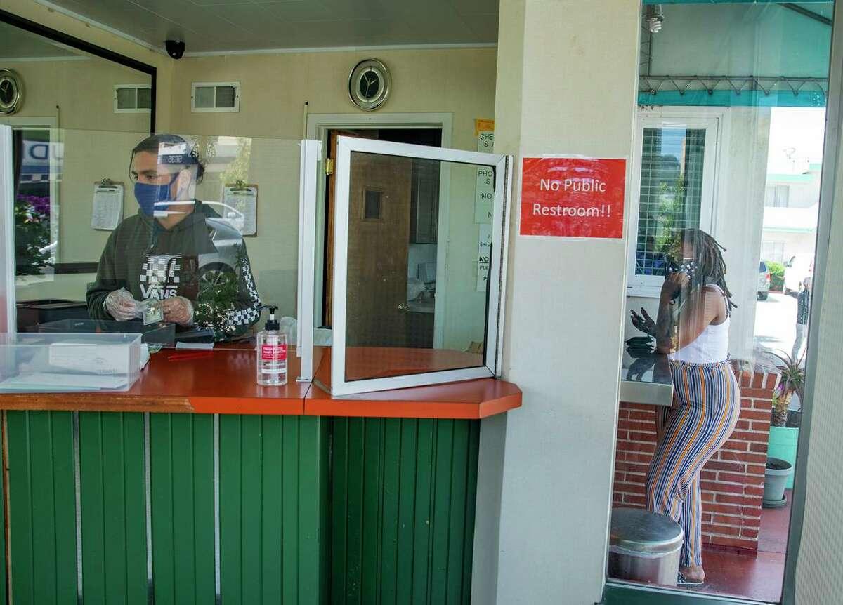 Eduardo Ugarte checks in a customer at the Mission Inn in San Francisco.