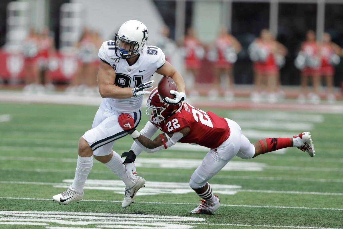 Connecticut tight end Jay Rose (91) is tackled by Indiana defensive back Jamar Johnson (22) during the first half of an NCAA college football game, Saturday, Sept. 21, 2019, in Bloomington, Ind. (AP Photo/Darron Cummings)