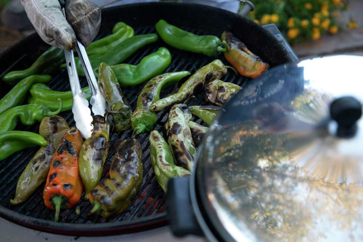 You can roast Hatch chile in your oven, on a grill (as seen here) or with a cast-iron skillet on your stove. Having a cold beer or plenty of sangria is recommended.