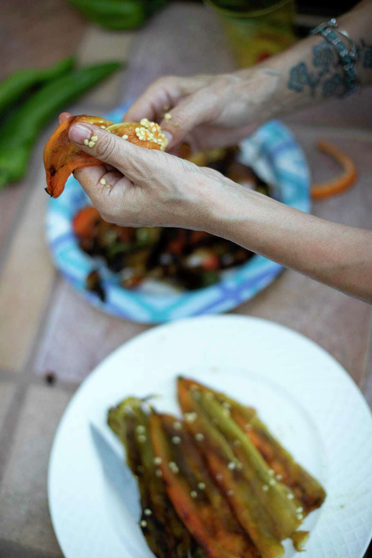 It's easier to peel roasted chile with your bare hands than while wearing gloves, but be sure to be very carefully wash your hands afterward.