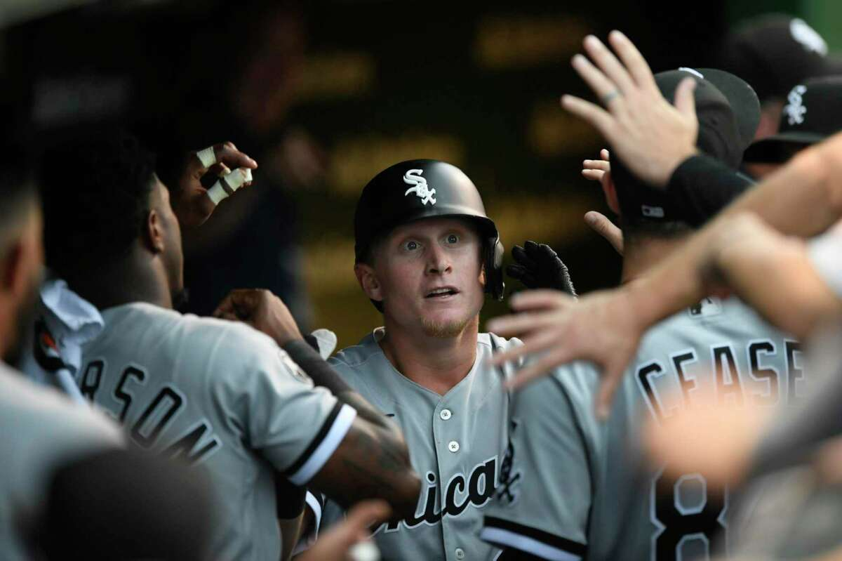 Chicago White Sox's Andrew Vaughn celebrates with teammates in the dugout after hitting a two-run home run during the first inning of a baseball game against the Chicago Cubs, Sunday, Aug 8, 2021, at Wrigley Field in Chicago. (AP Photo/Paul Beaty)
