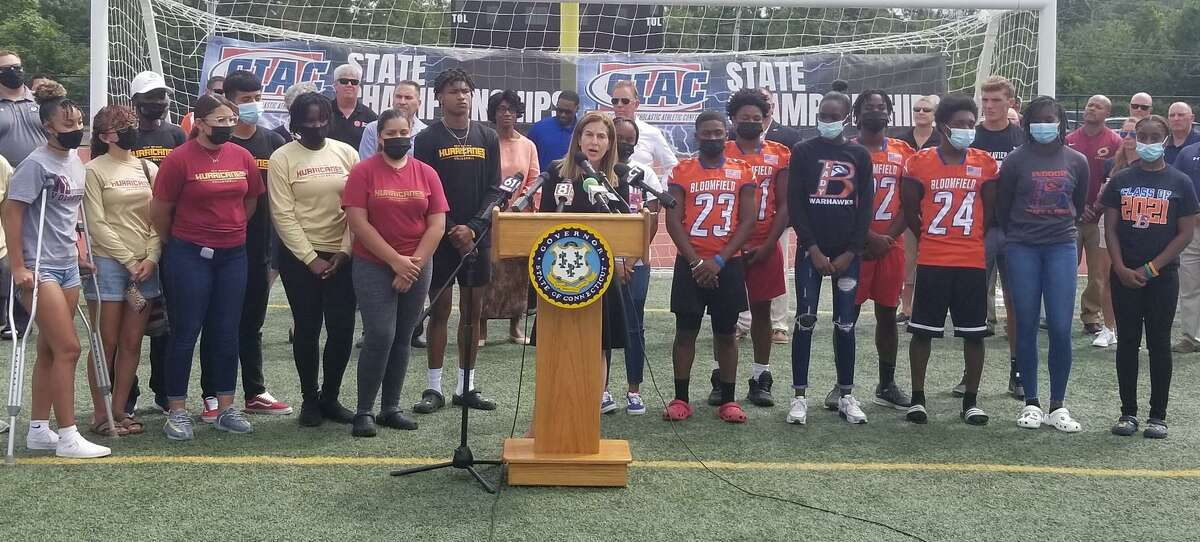 Lt. Gov. Susan Bysiewicz with high school student-athletes at a press conference in New Britain on Tuesday, Aug. 17, 2021.